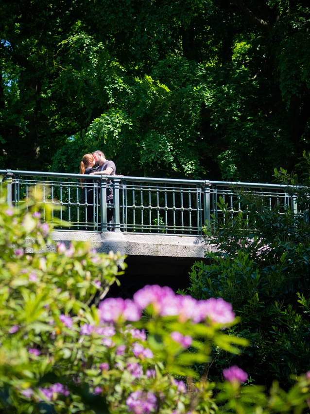 Photograph of Claire & Paul standing on a bridge in Sefton Park, Liverpool during their Pre Wedding Shoot.