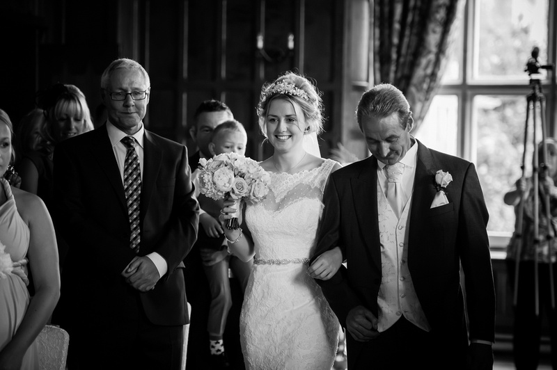 The bride walking down the aisle. Wedding at Chateaux Rhianfa, Anglesey. Wedding Photographer, Celynnen Photography