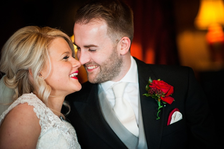 Bride and Groom Happy on Wedding Day at Ruthin Castle by photographer Celynnen Photography