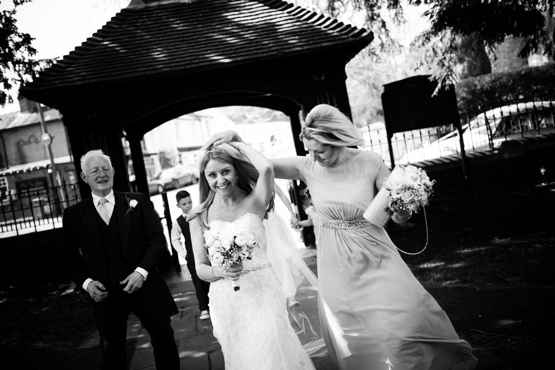 Black and white image of the bride arriving at the church for a wedding in Buckinghamshire.