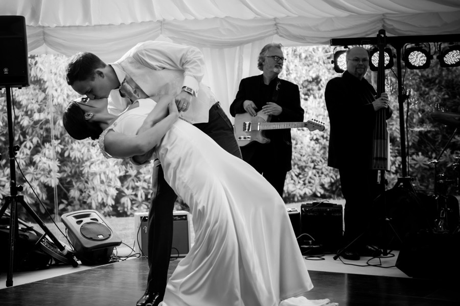 Black and white image of the bride and groom during their first dance at their wedding reception at Tros-yr-Afon, Anglesey. Wedding Photographer, Celynnen Photography