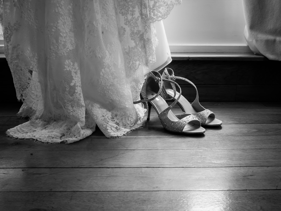Black and white photo of the bride's wedding shoes during bridal preparations at a wedding in Portmeirion.