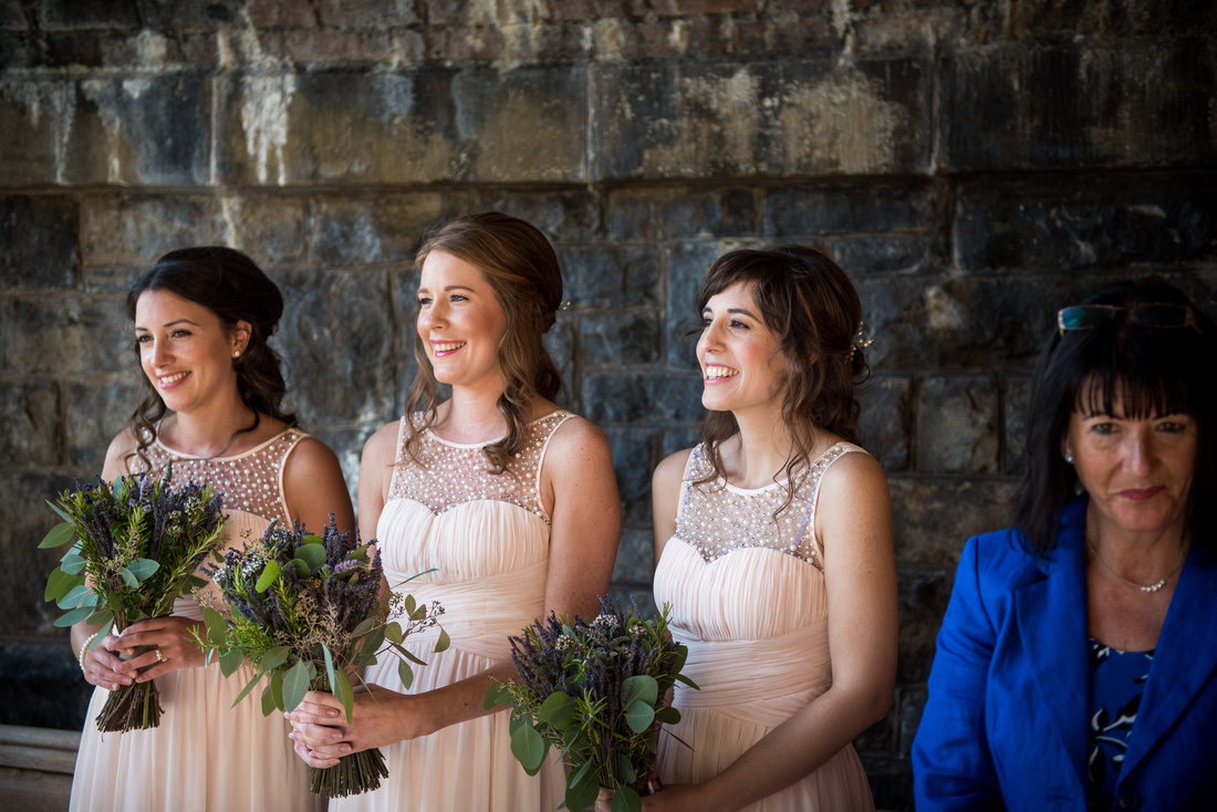 Image of the bridesmaids during the wedding ceremony at Tower Hill Barns.