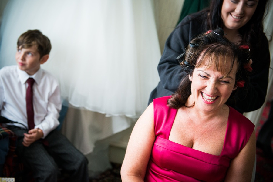 Mother of the bride getting ready for her daughter