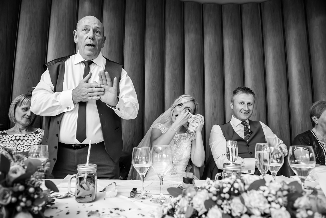 Black and white image of the father of the bride giving his speech at a wedding in Portmeirion.