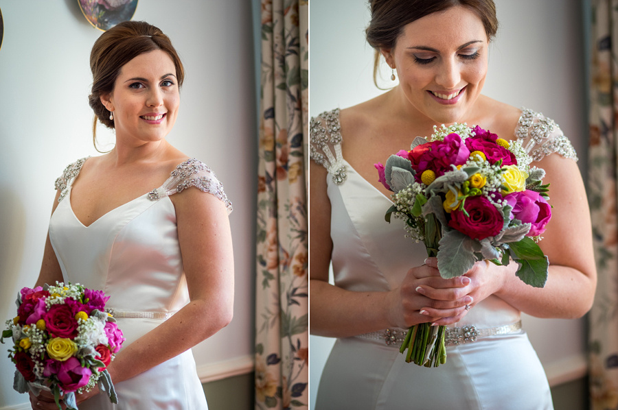 Amy in her Maggie Soterro dress with her flowers from Bluebells in Llanfair PG before her wedding in Beaumaris