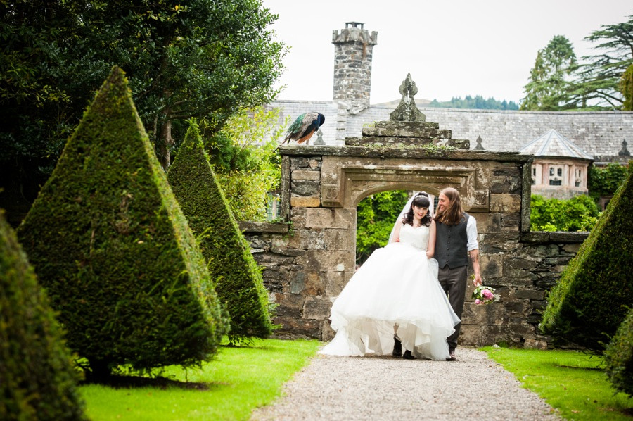 Bride and groom walking around the grounds at Gwydir Castle, by Celynnen Photography, North Wales wedding photographer of the year
