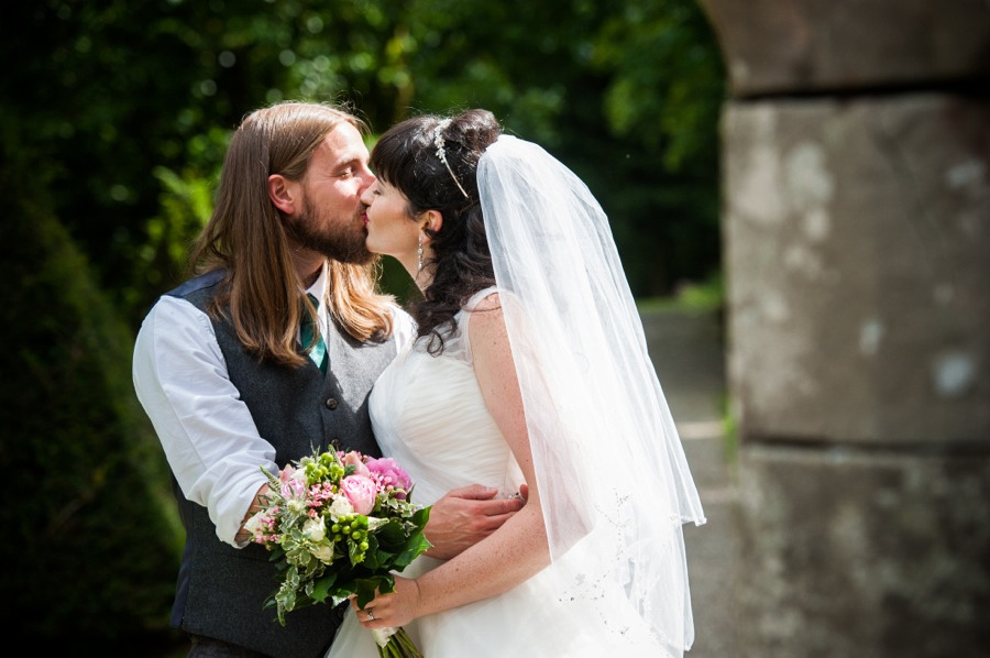 Bride and groom kissing on their wedding day at Gwydir Castle, by Celynnen Photography
