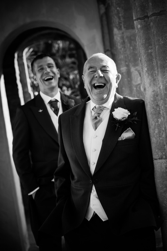Groom and guest enjoying their time at a wedding in Portmeirion.