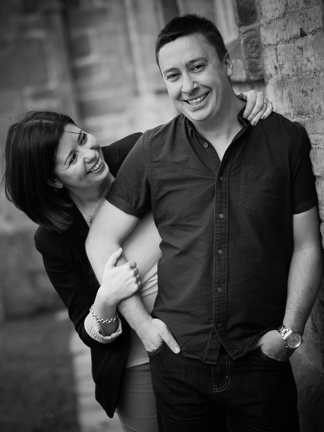 A photograph of Katharine & Matt on their Pre Wedding Shoot at Lyme Park, Cheshire.  Photographed by Celynnen Photography, black & white shot of the couple laughing.