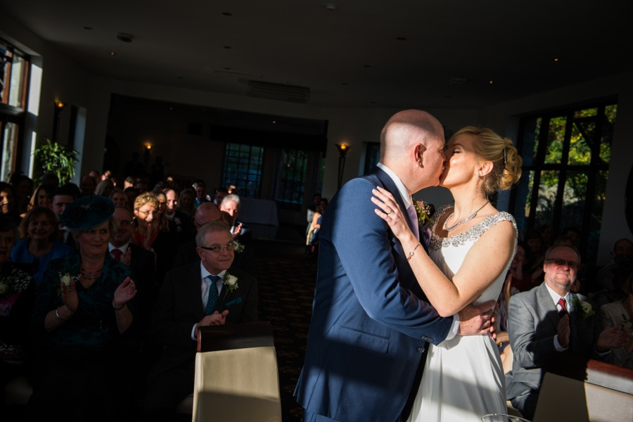 Bride and Groom kissing at the end of the ceremony by North Wales Wedding Photographer Celynnen Photography