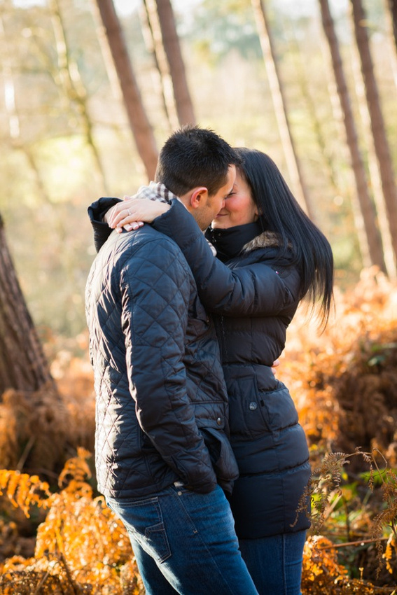 Photo of engaged couple about to kiss on their pre wedding shoot in Delamere Forest.
