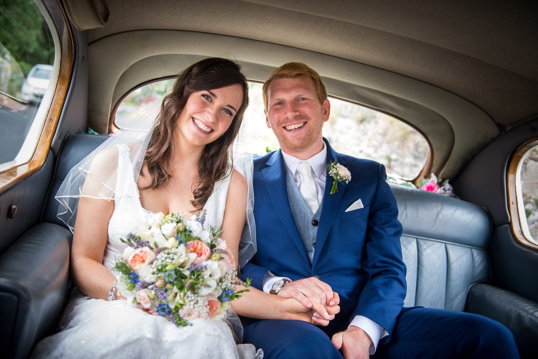 Image of the bride and groom in the car on the way to their wedding reception at Plas Isaf.
