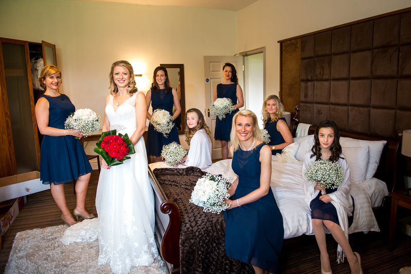 Portrait of the bride and the bridal party at a wedding in Davenham.