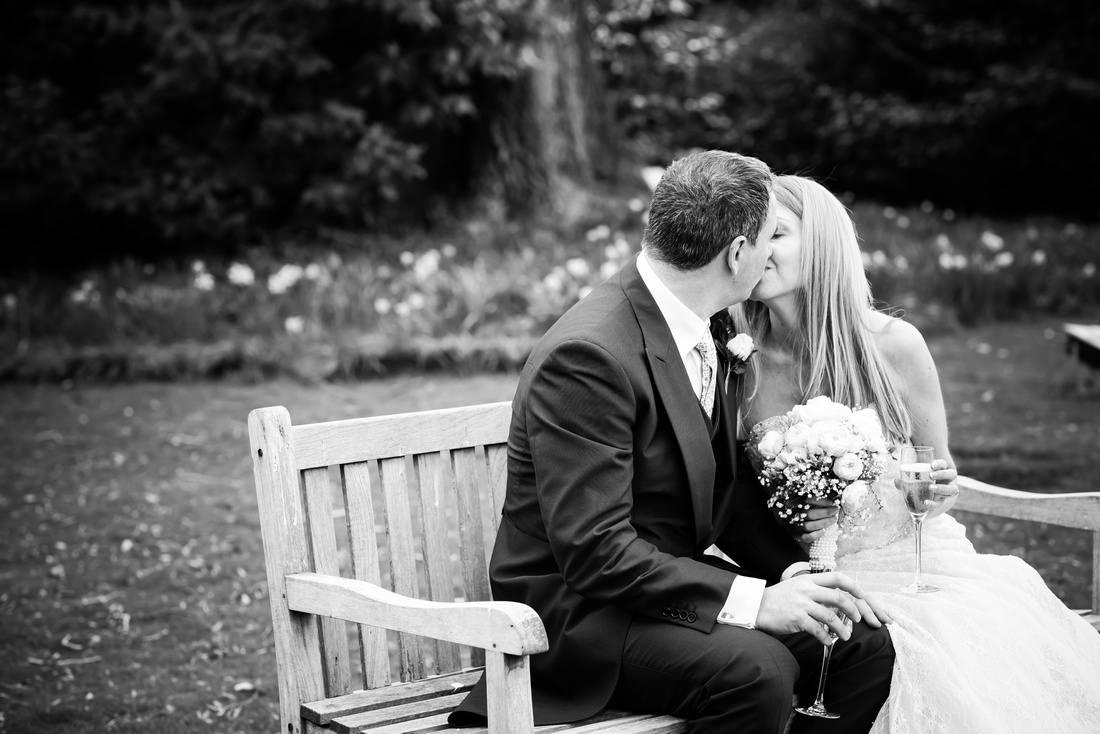 Black and white image of the bride and groom sharing a kiss in the grounds of the Taplow House, Buckinghamshire