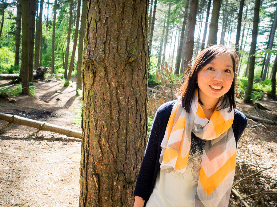 Photograph of Lisa by a tree in Delamere Forest. Celynnen Photography. Pre Wedding Shoot. Dan & Lisa