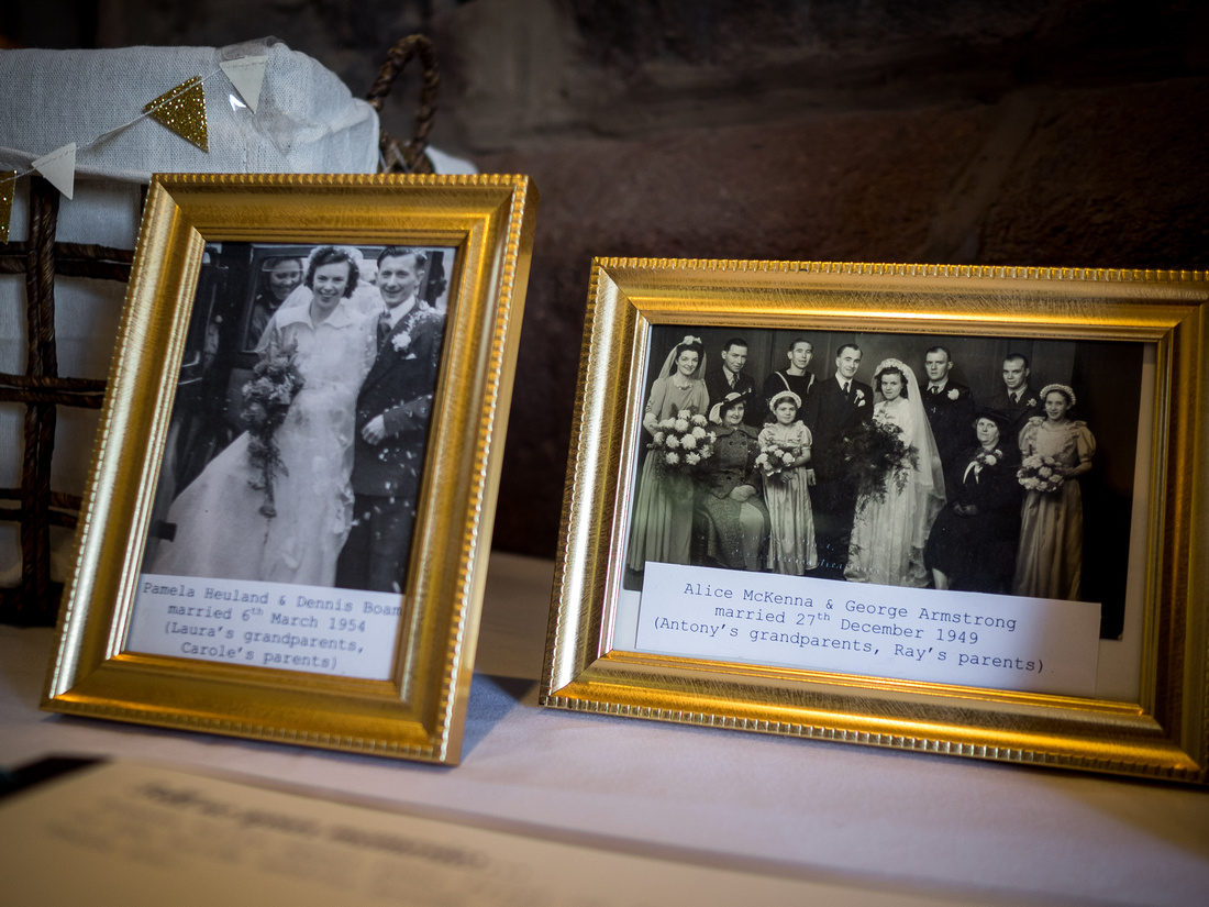 Image of framed photographs of bride and groom's grandparents on their wedding day, from a wedding at Beeston Manor.